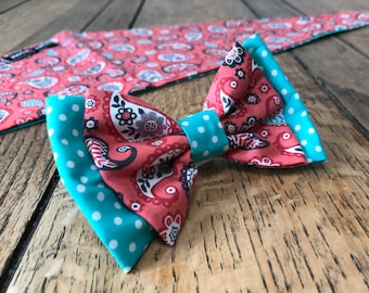 Handmade Double Dog Bow in Coral Paisley Fabric with contrasting Turquoise Polka Dot