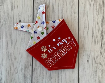 Birthday Dog Bandana in red with a rainbow paw print fabric.
