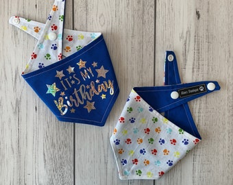 Birthday Dog Bandana in blue and multicoloured paw prints fabric.