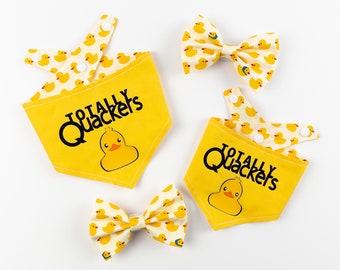 Reversible vibrant bright yellow Dog Bandana with a totally quackers Vinyl print