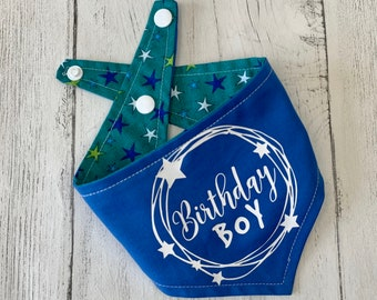 Birthday Boy vinyl print double sided dog Bandana in bright blue with a green, blue and white stars fabric.