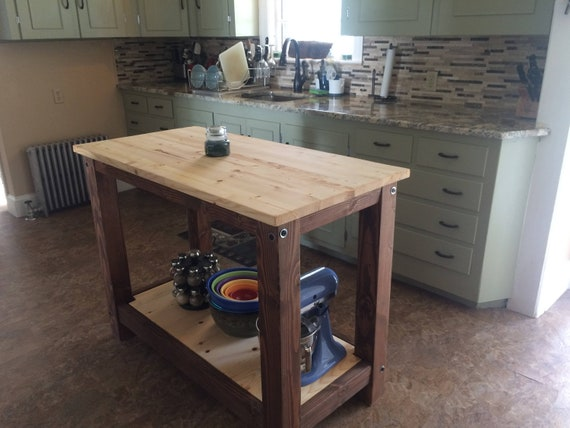 1 full shelf - Farmhouse Kitchen Island, Butcher block style table Rustic  wood appearance at an affordable price.