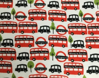 25 inches of Flannel/London transportation on white background cotton fabric