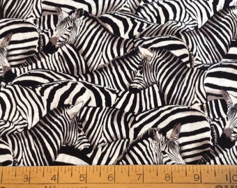 Black and white stacked zebras cotton fabric by the yard