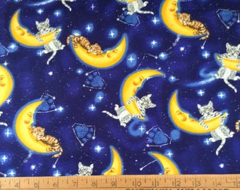 35 inches of Cat hanging on a crescent moon cotton fabric