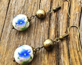 Gold and blue floral dangle earrings