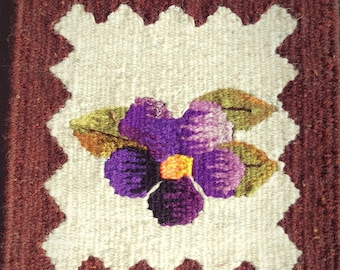 Small decorative carpet/ handmade/ wall /table decoration/ purple flower on soft cream background with brown border