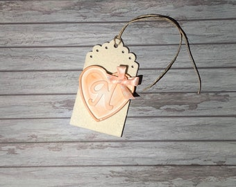 Tags with chalk-shaped heart and initial