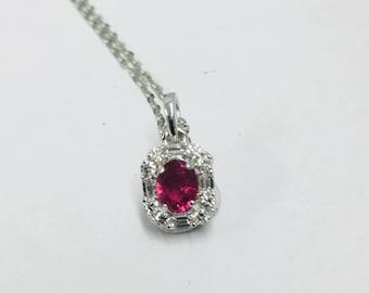 8b3ad1987550 18ct white gold ruby diamond pendant