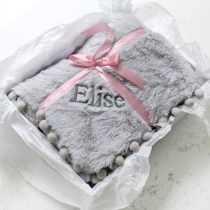 Personalised knitted pom pom fleece lined baby blanket