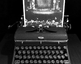 Black and white photo illustration of antique typewriter with theater stage photo