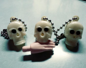 Mechanical chomping jaw skull charms from 1960's NOS, vending machine gumball prizes
