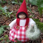 Little Red Riding Hood. Tiny doll made from woolfelt, cotton and wool. For a seasonal table, decoration or storytelling.