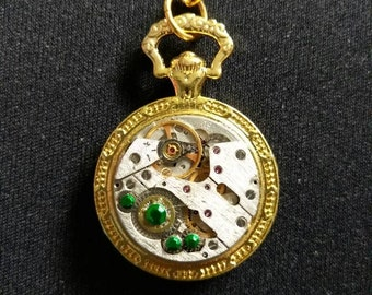 Steampunk watch movement necklace gold and green rhinestones