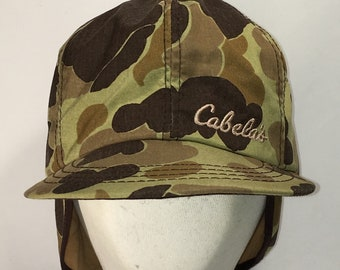 19caa1d5d7978 Cabelas Hunting Camo Hat with Ear Flaps Size Small Mens Winter Hats Made In  USA Baseball Cap Bill Dad Caps Gifts For Men Gifts T121 M9106