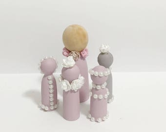 A Floral/Pearl Peg Doll