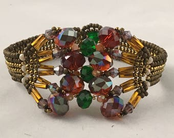 Handmade bracelet red cooper gold purple green brown green crystals beaded