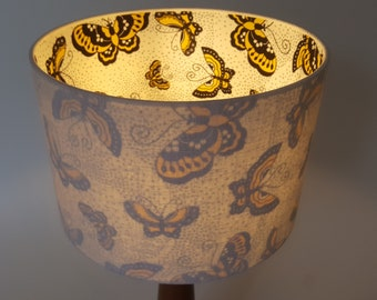 Drawn to the light. Moths inside White textured Linen 'Duo' lampshades