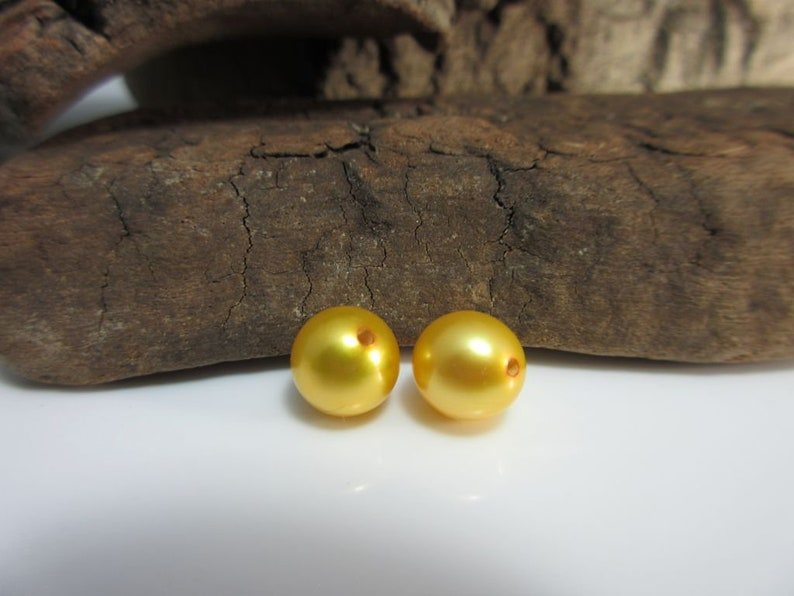 Beads gold-colored 2 pieces drilled 8.0-8.5 mm AAA+