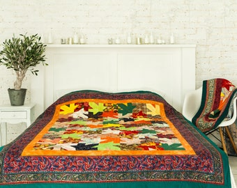 Colorful handmade quilt blanket with leaves