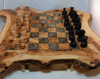 Chessboard and rustic chess set in olive wood