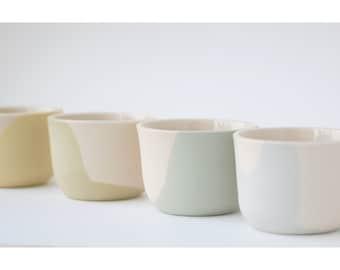 Set of 4 small ceramic cups. Tea cups. Pastel color. Minimalist decor. Design object. Modern pottery