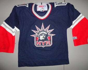 Blue Red White Vintage 90 s SEWN Lady Liberty New York Rangers NHL Hockey  CCM Jersey Youth S 74c4694d6