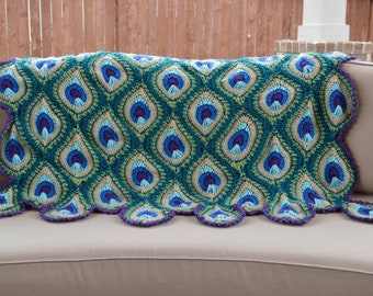 """PEACOCK FEATHER BLANKET approx. 75"""" x 55"""" inches. Made from 94 individual motifs evoking the beauty of a fanned peacock tail."""
