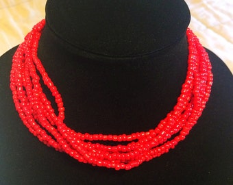 Red multi strand necklace.