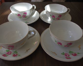 Lot of 4 cups of coffee with floral design. Unused. Brown vintage game. Old coffee game. White porcelain.