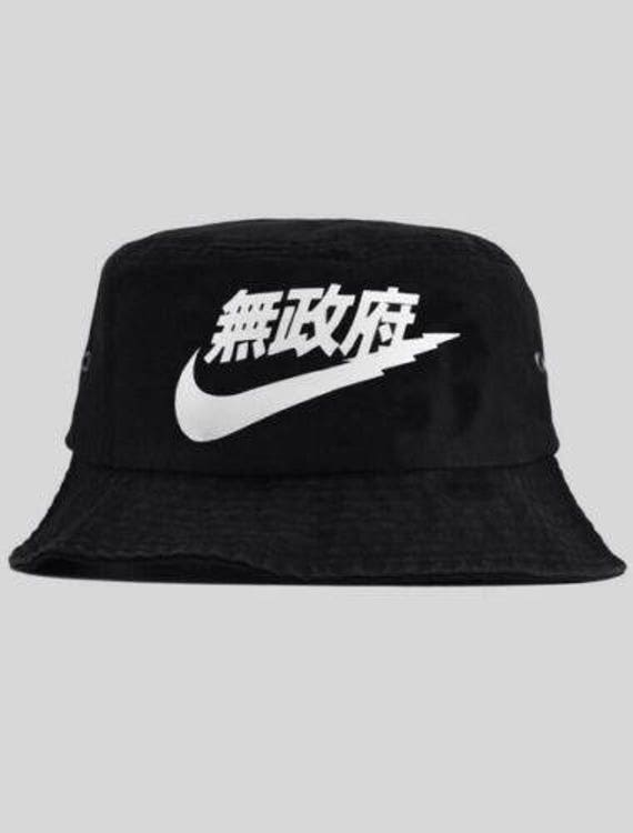 3f265dc01ccc8 ... czech new nike air tokyo japanese bucket hat yung lean x nike etsy  89805 57eee