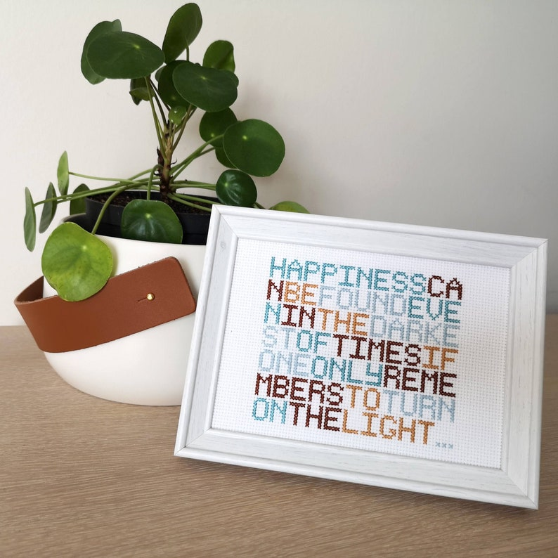 Happiness can be found  Dumbledore Harry Potter  cross image 0