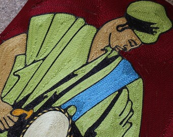 Embroidered african drummer