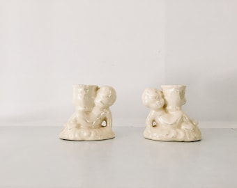 Pearlescent iridescent pair of 1970s cream cherub candle holders twin vintage cute