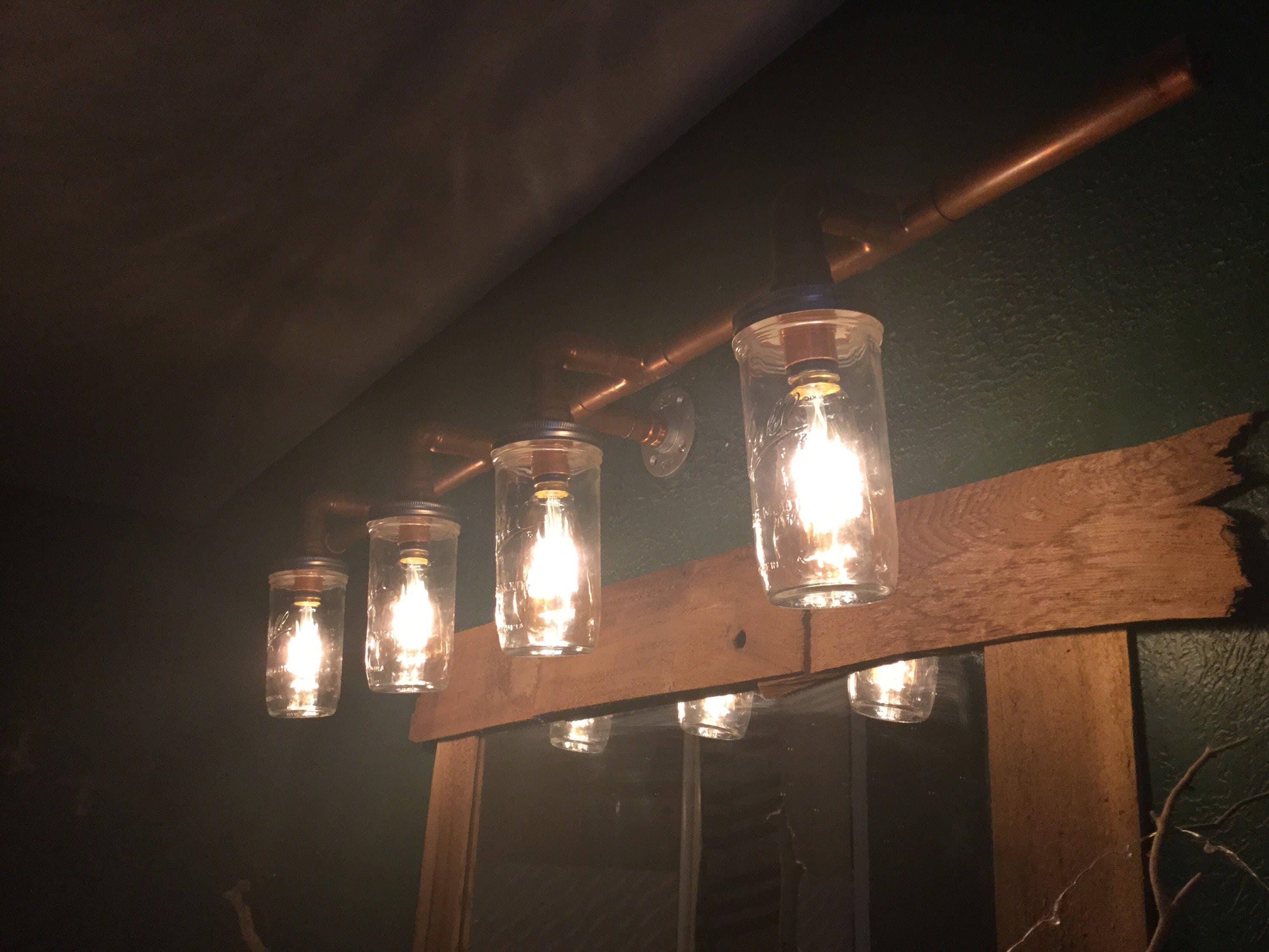 Rustic industrial copper pipe and mason jar light fixture