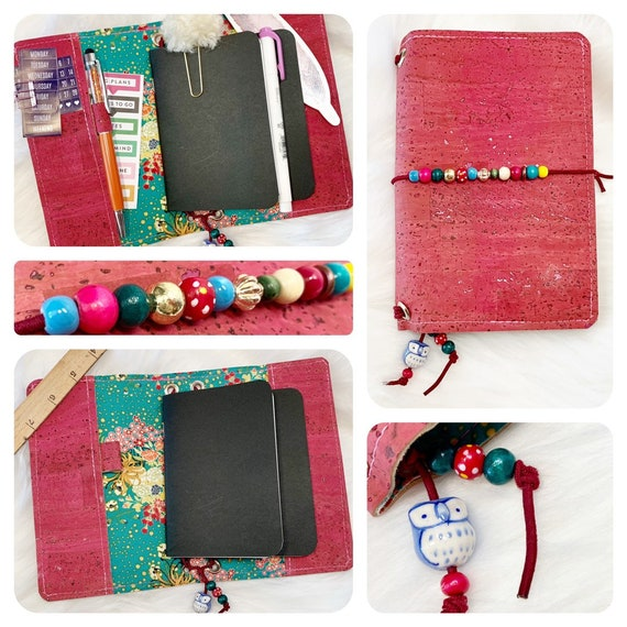 Field notes size natural cork TN traveler's notebook is motley in magenta, bohemian florals, and mixed and matched beads.  Inserts included!