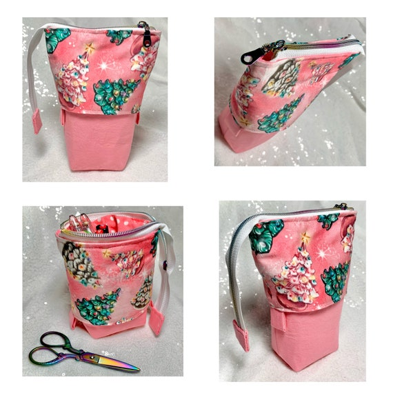 So clever! Pink ceramic Christmas tree themed sliding standing pen pouch.  Keep your writing tools close at hand, even on the go!