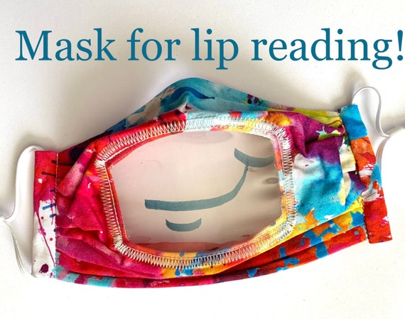 Lip reading cloth face mask with clear vinyl window. Adjustable pleated cotton face mask shows the mouth to help with communication.