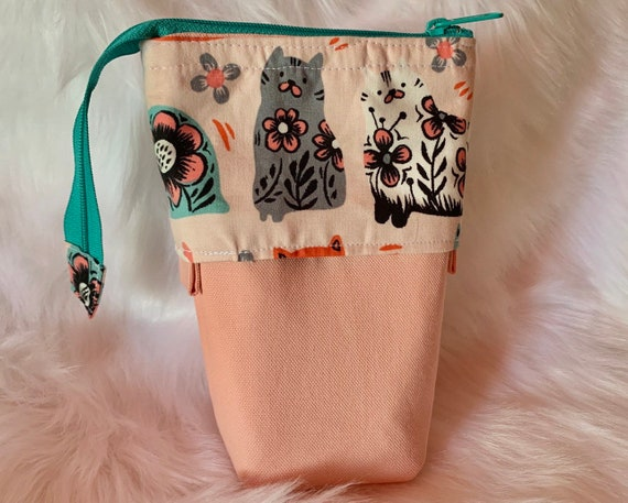 So clever! Sliding stand up pencil pouch in a yummy peach shade and cute folkart cat design
