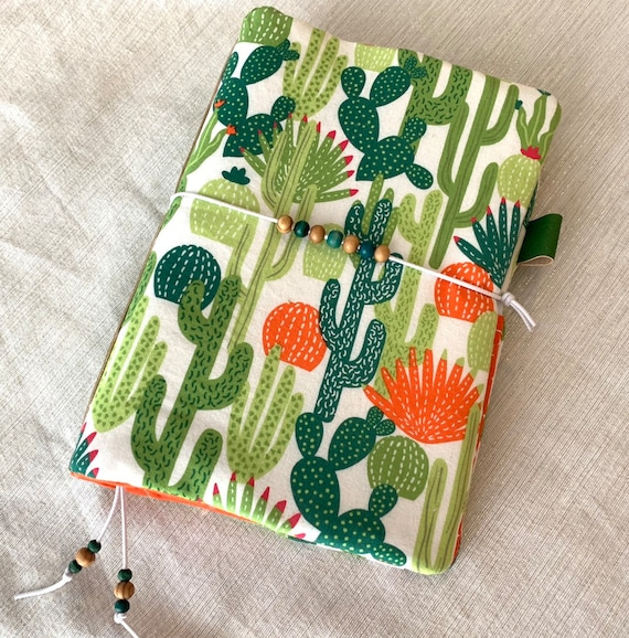 Fun and trendy cactus themed refillable A5 size notebook with orange accents and matching cork fabric spine!