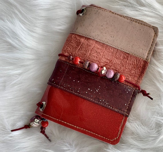 Field notes size TN natural cork traveler's notebook in patchwork red with glittering beads.  Artist made cover, includes a notebook