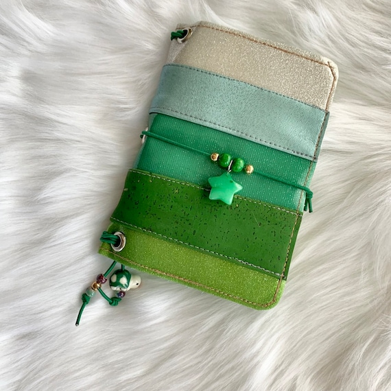 Field notes size TN natural cork traveler's notebook in patchwork green with charming beads.  Artist made cover, includes a notebook