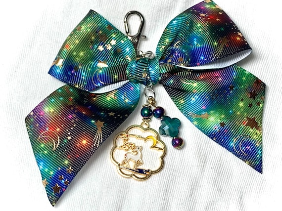 Dazzling bow charm with dark night sky ribbon and Japanese style enamel deer pendant. Unique eye candy to embellish your planner or bag!