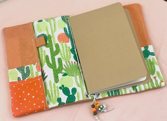 Refillable A5 cork notebook, pastel orange cork with cactus printed fabric accents and pockets.  Inserts included!