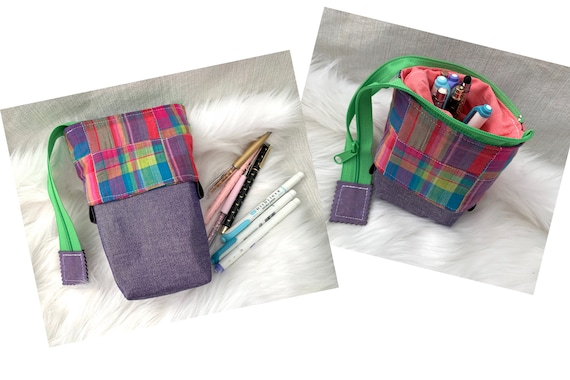 So clever! Brightly colored plaid standing sliding pen pouch with glitzy purple fabric