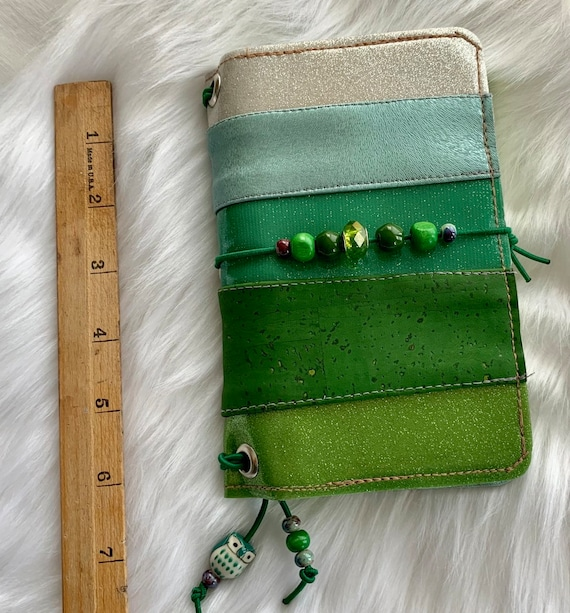 Field notes size TN natural cork traveler's notebook in patchwork green with glittering beads.  Artist made cover, includes a notebook