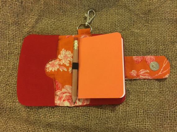 Clip-on mini notebook card wallet red canvas with magnetic snap closure, notebook, and pencil.  Great for business cards!