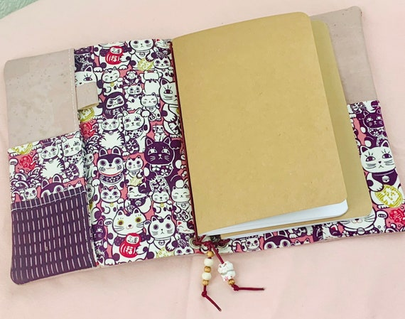 Refillable A5 notebook in dusty pink cork fabric and a cute Maneki Neko lucky cat printed fabric accents and pockets.  Inserts included!