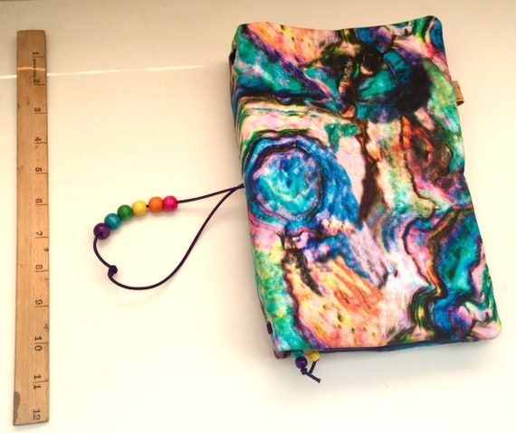 Dazzling OOAK rainbow printed refillable A5 notebook with many pockets.  Elastic bands for notebook inserts plus room for a hardbound A5 jou