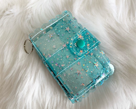 Take note!  Aqua jelly clip-on mini travelers notebook TN complete with handmade inserts. It's sparkly cuteness to go!